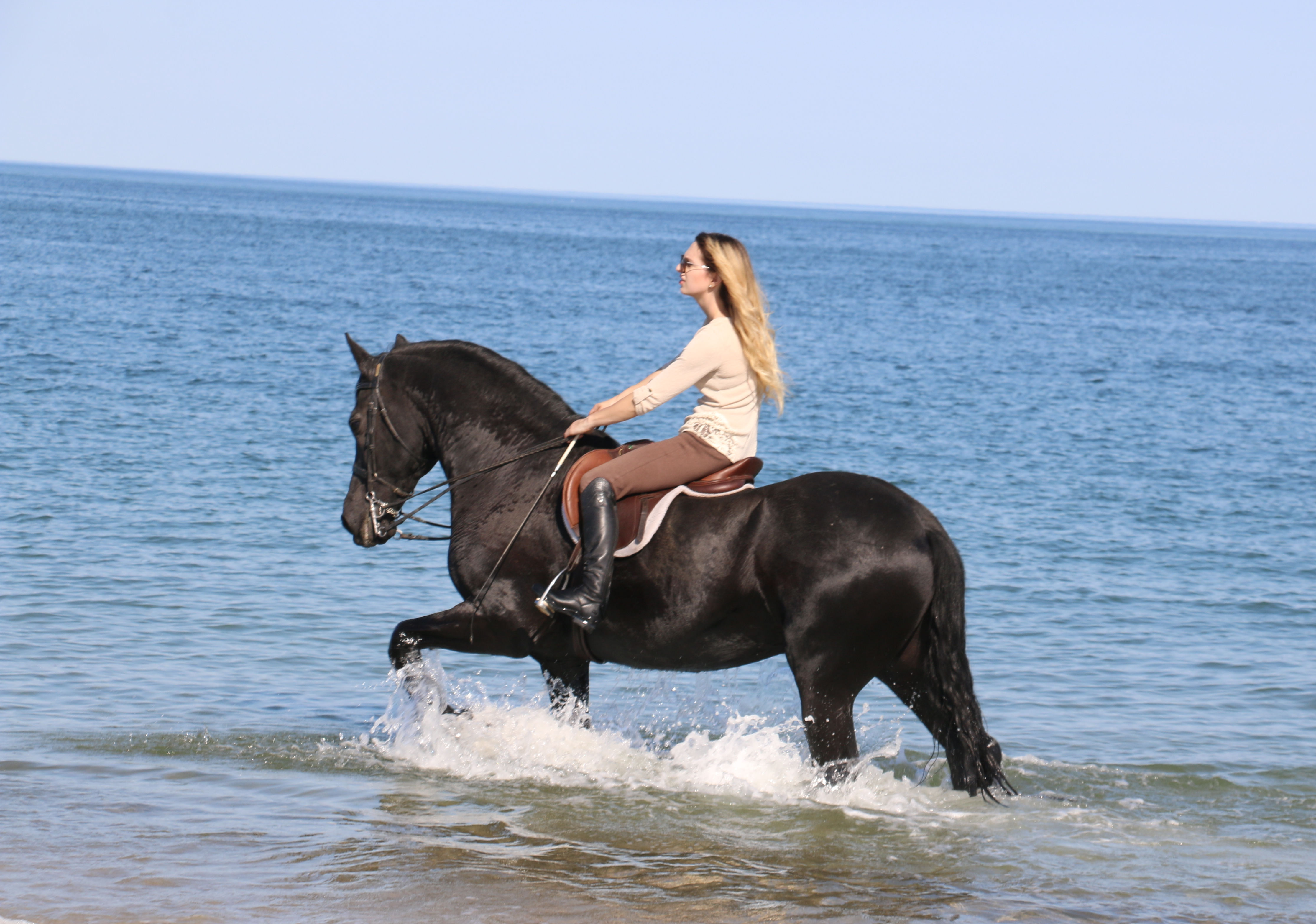 Carly and Bouke riding at Crane beach