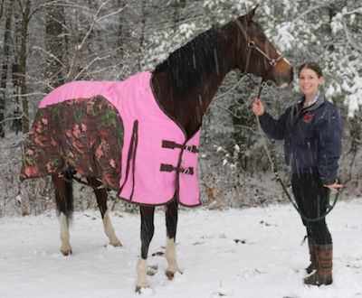 Chrislar boarder enjoying a walk around the property with her horse after a winter ride