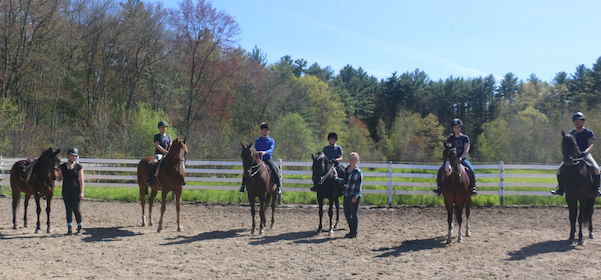 Chrislar students in a group riding lesson with riding instructor Sarah Keyes